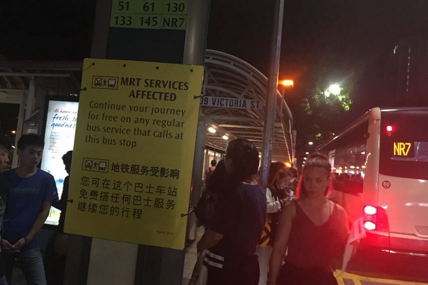 Affected commuters board buses at the bus stop outside Bugis MRT.