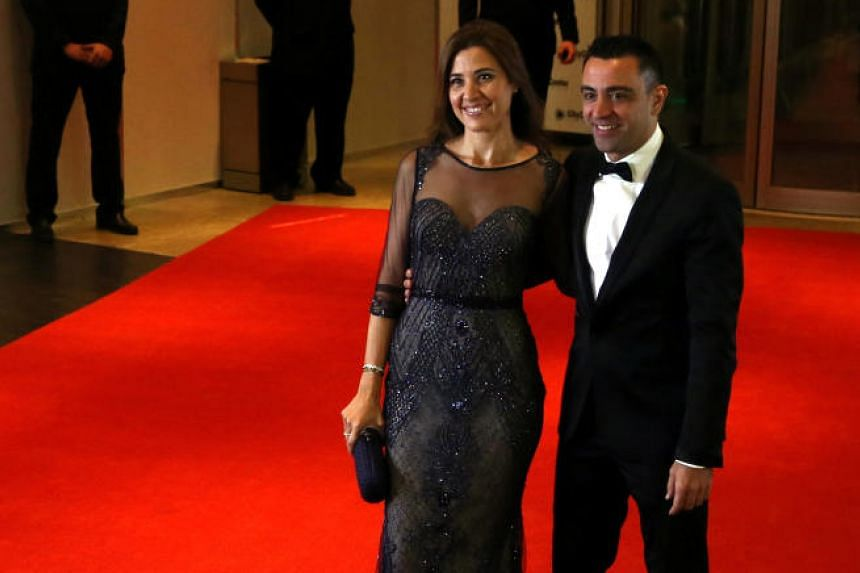 Xavi Hernandez and his wife Nuria Cunillera arrive for the wedding of Messi and Antonela Roccuzzo in Rosario, Argentina, on June 30, 2017.