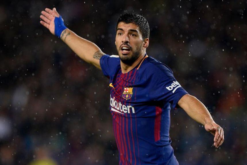 Barcelona's Uruguayan forward Luis Suarez reacts during the Spanish league football match FC Barcelona vs Sevilla FC at the Camp Nou stadium in Barcelona on Nov 4, 2017.