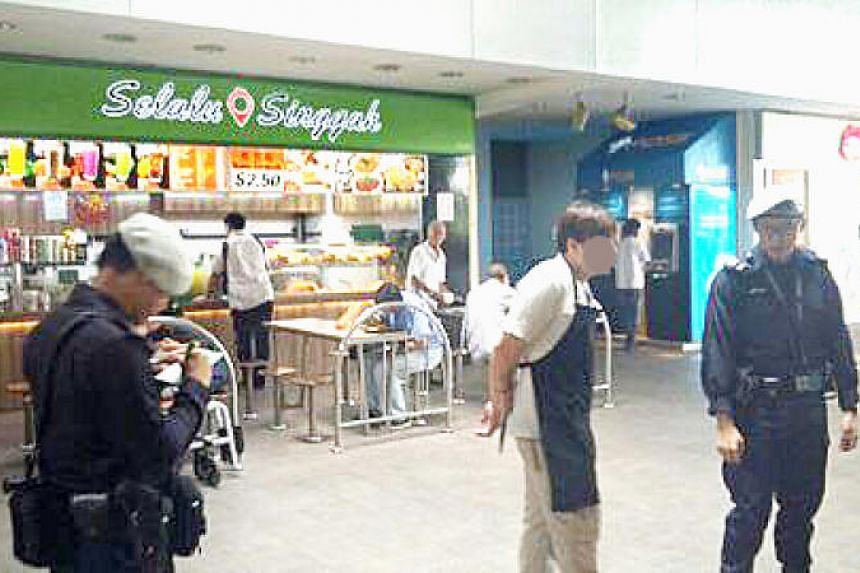 Police seen at the hawker centre at Pasir Ris MRT station questioning an employee of the char siew stall.