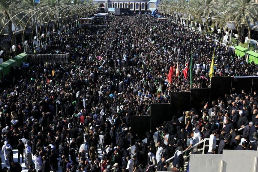 Shiite pilgrims gather near the Imam Hussein shrine during ceremonies marking Arbain in the holy city of Karbala, southern Iraq, on Nov 10, 2017.
