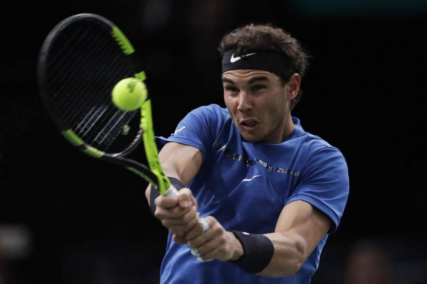 Spain's Rafael Nadal returning the ball to Uruguay's Pablo Cuevas during the 1/8 round at the ATP World Tour Masters 1000 indoor tennis tournament in Paris on Nov 2, 2017.