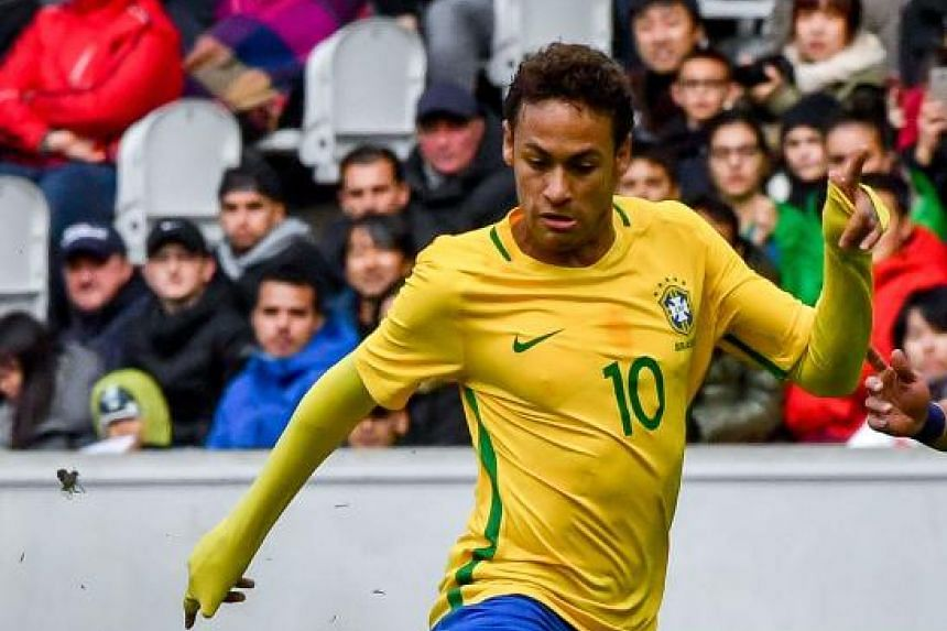 """Brazil's forward Neymar controls the ball during a friendly football match between Japan and Brazil at The """"Pierre Mauroy """" Stadium in Villeneuve d'Ascq on Nov 10, 2017."""