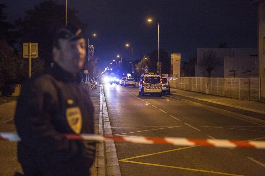 Police cars are parked near the IGS campus, in Blagnac, near Toulouse, France, on Nov 10, 2017.