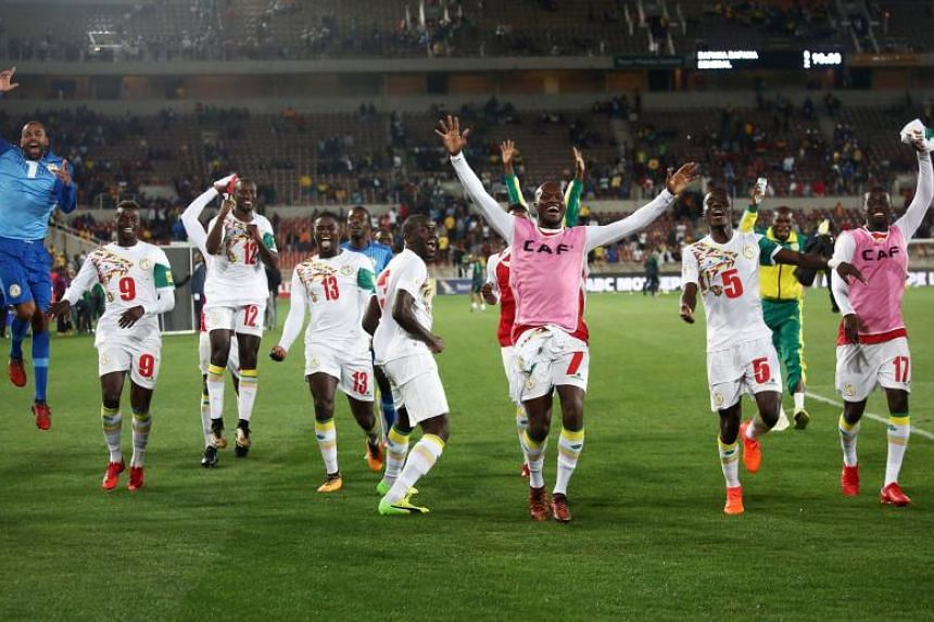 Senegal's players celebrate after winning the Fifa 2018 World Cup Africa Group D qualifying football match between South Africa and Senegal at The Peter Mokaba Stadium in Polkowane on Nov 10, 2017.