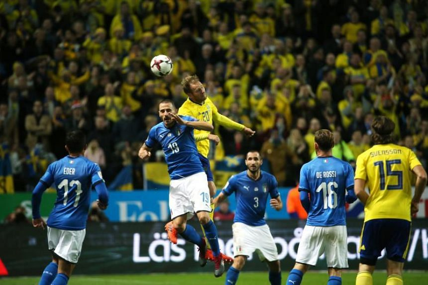 Sweden's forward Ola Toivonen heads the ball over Italy's defender Leonardo Bonucci during the Fifa World Cup 2018 qualification football match between Sweden and Italy in Solna, on Nov 10, 2017.