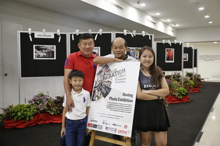 (From left) Mr Lawrence Pang and his son Jordan, with Open Category winner Desmond Teo and Youth Category winner Julia Chee.