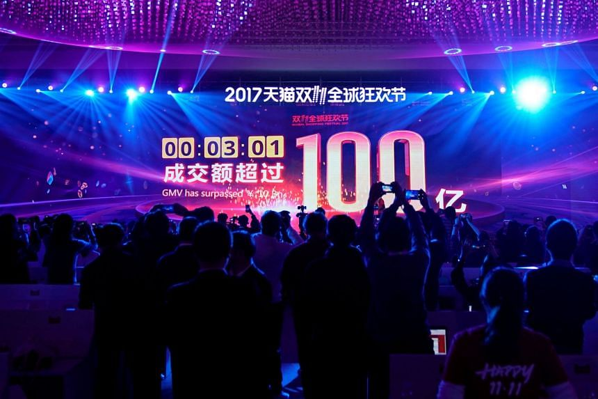 A screen shows the value of goods being transacted at Alibaba Group's 11.11 Singles' Day global shopping festival in Shanghai, China, on Nov 11, 2017.