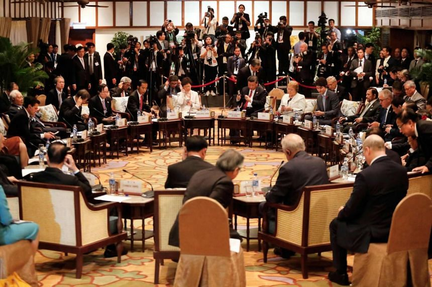 Leaders attend the APEC-ASEAN dialogue on the sidelines of the Asia-Pacific Economic Cooperation (APEC) leaders' summit in the central Vietnamese city of Danang on Nov 10, 2017.