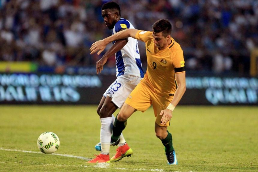 Tomi Juric of Australia and Johnny Palacios of Honduras in action during the match.