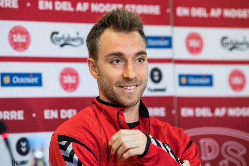 Denmark's national soccer team player Christian Eriksen addresses a news conference the day before the World Cup qualification match against Ireland.