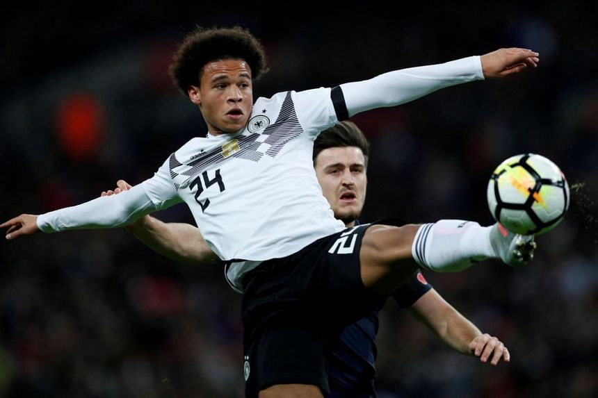 Germany's Leroy Sane (front) in action with England's Harry Maguire in a lively Wembley friendly on Friday (Nov 10).