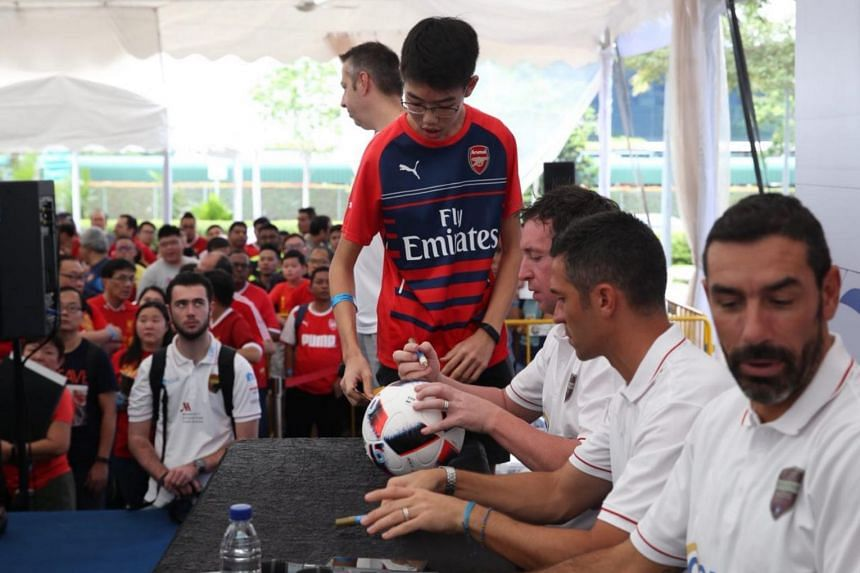 The Straits Times reader Guy Tan gets his football signed.