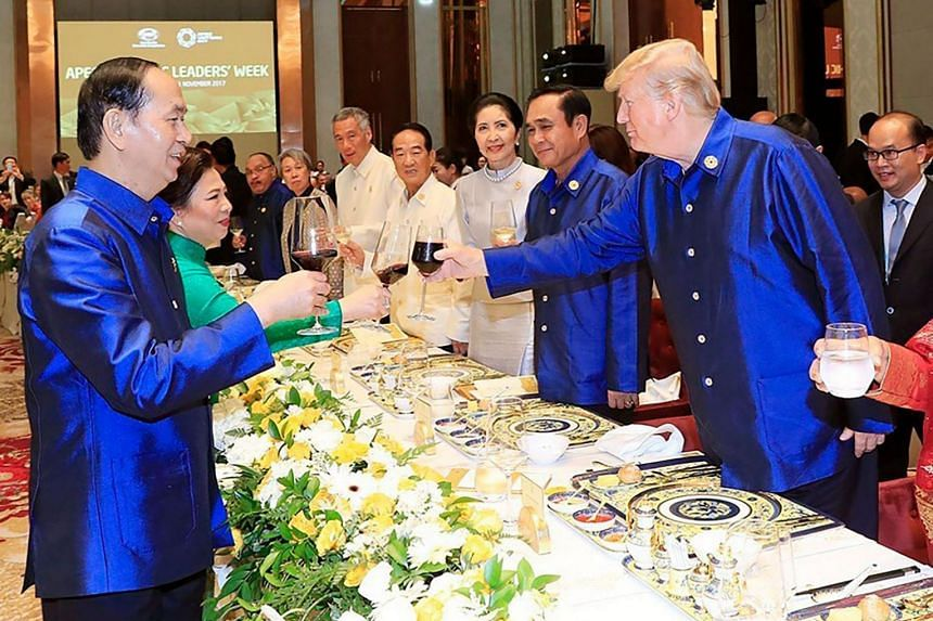 Vietnam's President Tran Dai Quang (left) makes a toast with US President Donald Trump (right) at the start of the Asia-Pacific Economic Cooperation (APEC) Summit leaders gala dinner in the central Vietnamese city of Danang on Nov 10, 2017.