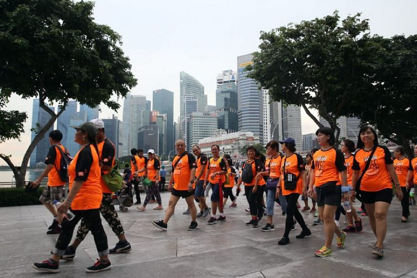 More than 2000 participants took part in the OnePeople.sg's Orange Ribbon Walk 2017 on Nov 11.