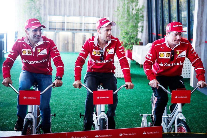 Ferrari drivers Sebastian Vettel (centre), Kimi Raikkonen (right) and test driver Marc Gene participate in an event at the Interlagos racetrack ahead of the Brazilian Grand Prix this weekend.