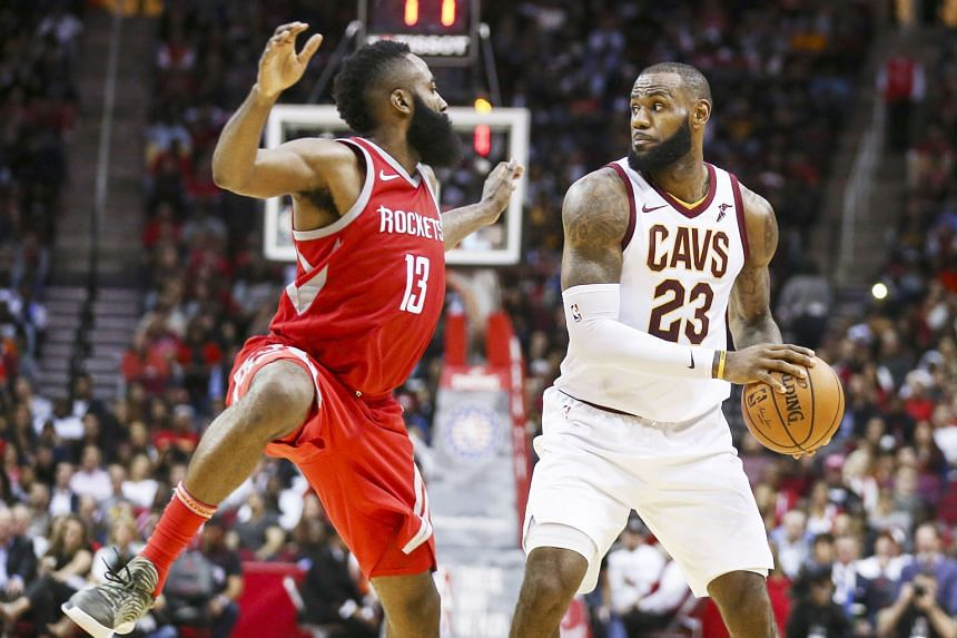 Cleveland Cavaliers forward LeBron James taking control of the ball as Houston Rockets guard James Harden defends during the fourth quarter on Thursday. The Rockets beat the Cavs 117-113 in the National Basketball Association game.