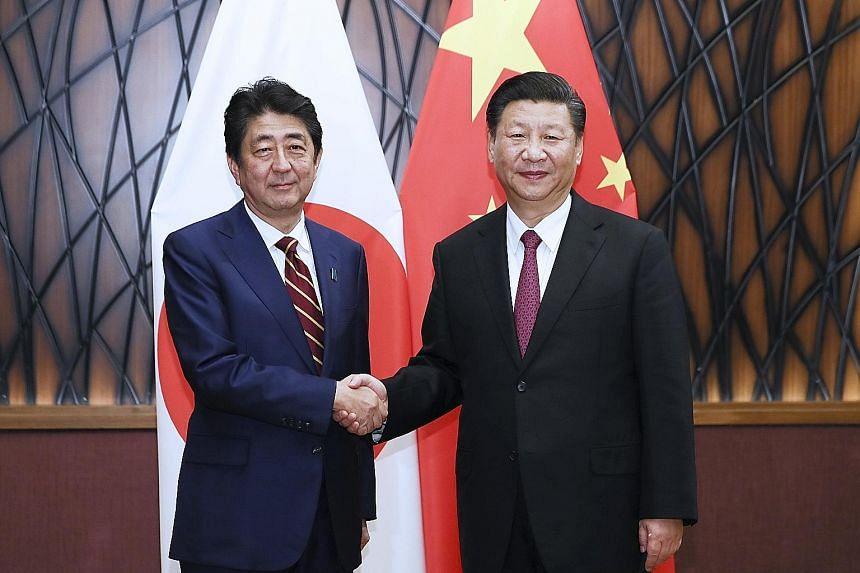 Japanese Prime Minister Shinzo Abe meeting Chinese President Xi Jinping in Danang yesterday.