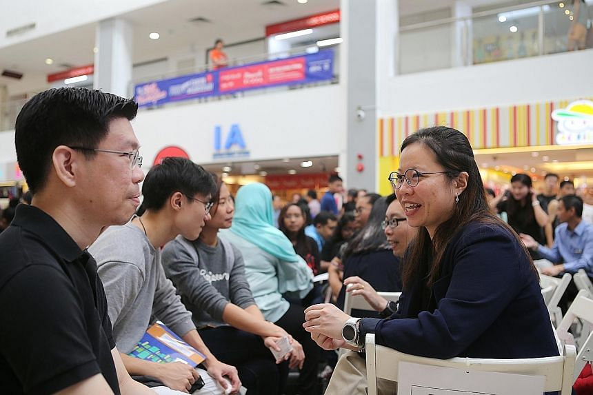 Business executive Felicia Kang, 27, speaking to one of the participants at the Todo Todo Skills Marketplace held at Sengkang's Rivervale Plaza yesterday. She is one of the mentors at the event.