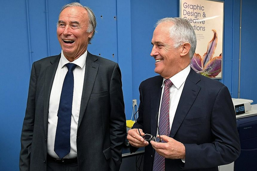 Mr John Alexander (left), with Mr Malcolm Turnbull in April, could not determine if he had inherited British citizenship from his father.