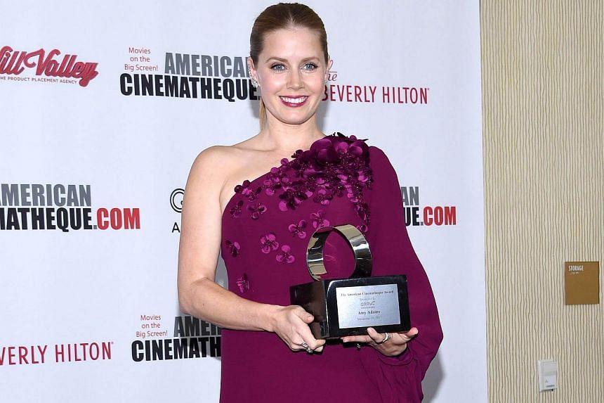 Actress Amy Adams posing with her American Cinematheque Award in Beverly Hills on Nov 10, 2017.