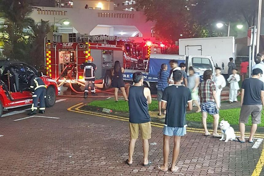 SCDF personnel conducting firefighting operations at the coffee shop, on Nov 11, 2017.