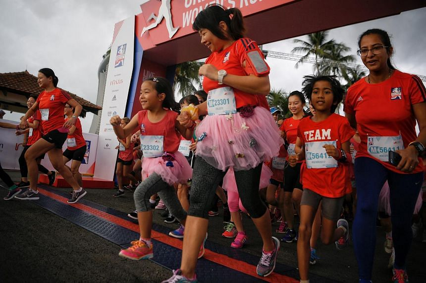 Mothers and their daughters leave the starting point during the 2km Mummy + Me category at the Great Eastern Women's Run.