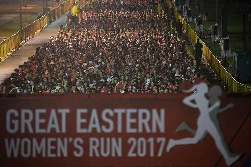 Participants line up before the 21.1km Half Marathon flag off at the Great Eastern Women's Run.