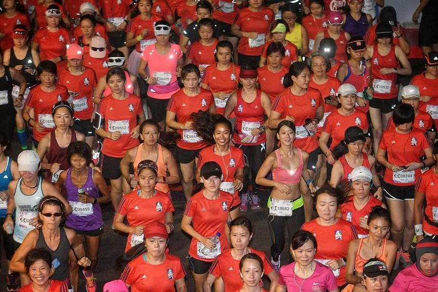 Participants in action during the 21.1km Half Marathon flag off at the Great Eastern Women's Run.