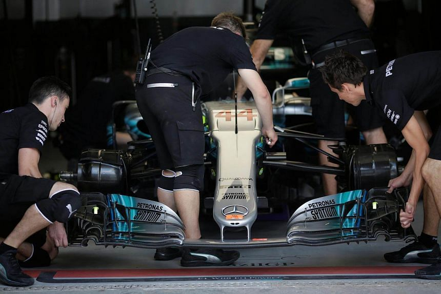 Team members of Mercedes work on Lewis Hamilton's car during second practice at the Interlagos racetrack in Sao Paulo, Brazil.