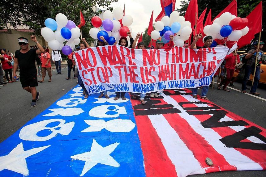 Protesters demonstrating against the visit by US President Donald Trump in Manila, on Nov 12, 2017.