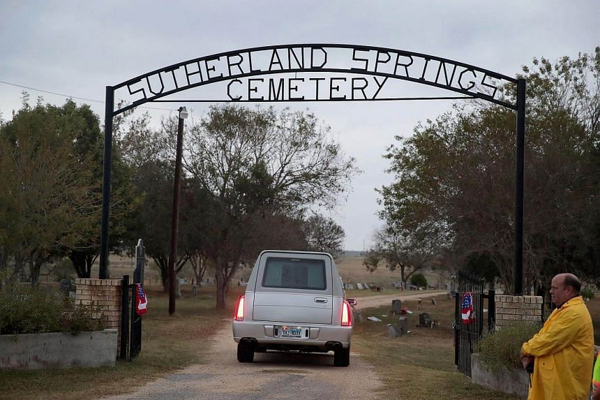Hearses carrying the remains of two of the victims arriving at the Sutherland Springs Cemetery in Sutherland Springs, Texas on Nov 11, 2017.