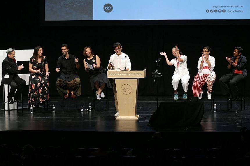 (From left) Adrian Tan, Arianna Pozzuoli, Rishi Budhrani, Petrina Kow, Gwee Li Sui, Ovidia Yu, Oniatta Effendi and Shamini Flint participating in the closing debate of the Singapore Writers Festival at Victoria Theatre on Nov 12, 2017.