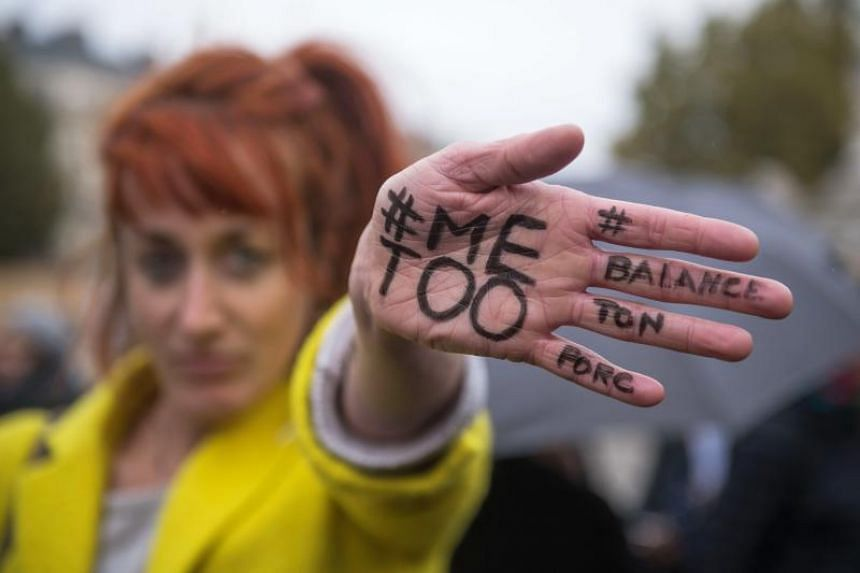 A woman shows a message reading #MeToo written on her hand during a rally against gender-based and sexual violence against women, in Paris, France, Oct 29, 2017. PHOTO: EPA-EFE