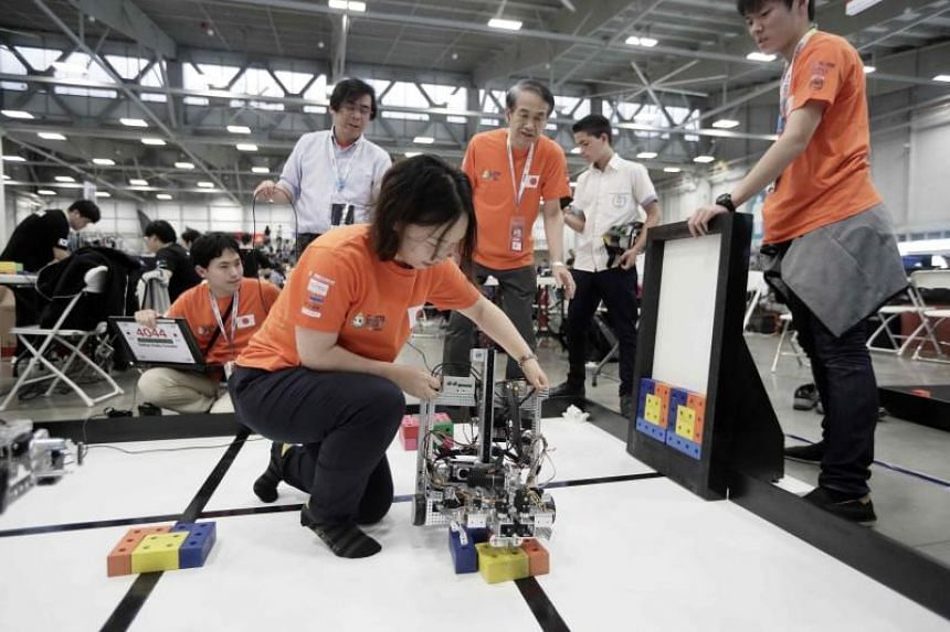 Students from Japan test a robot during the World Robot Olympiad in San Jose, Costa Rica, on Nov 10, 2017.