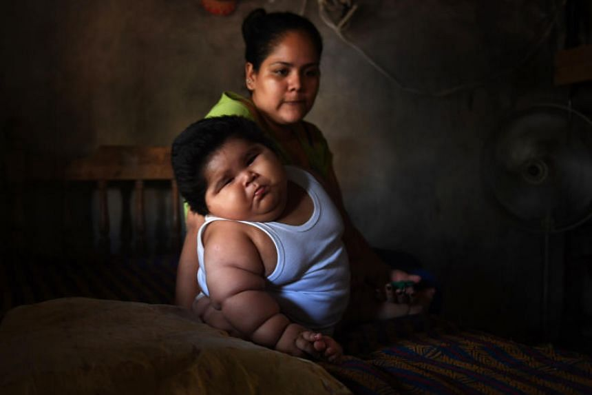 Ten-month-old Luis Gonzales and his mother Isabel Pantoja, 24, at their home in Tecoman, Colima state, Mexico on Nov 8, 2017.