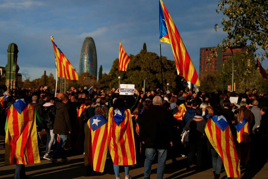 Protestors wear Esteladas (Catalan separatist flags) before a demonstration called by pro-independence asociations asking for the release of jailed Catalan activists and leaders in Barcelona, Spain, on Nov 11, 2017.