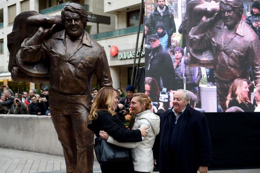 A bronze statue of late Italian movie actor Bud Spencer is being unveiled by (from left) his daughter Cristiana, Hungarian sculptor Szandra Tasnadi and his Hungarian water polo friend, three-times Olympic winner Gyorgy Karpati in Budapest on Nov 11,