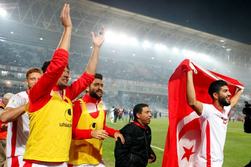 Tunisia's players celebrate qualifying for the World Cup after their match in Rades Olympic Stadium, Rades, Tunisia on Nov 11, 2017.
