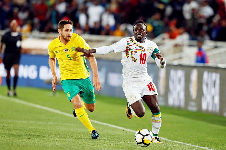 Senegal forward Sadio Mane outpacing South Africa midfielder Dean Furman on Friday. The Liverpool star was the difference as Senegal qualified for their second World Cup.