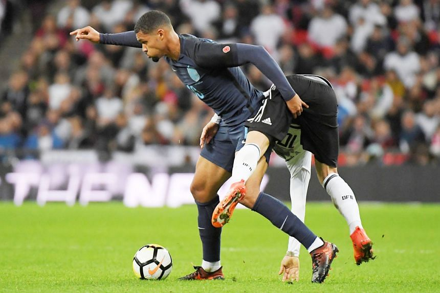 England midfielder Ruben Loftus-Cheek brushing off Germany's Mesut Ozil in a goalless friendly at Wembley on Friday. The 21-year-old debutant put on an impressive display in the middle of the park against the world champions to earn the Man-of-the-Ma
