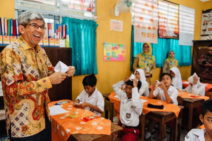 Singapore's Minister for Communications and Information Dr Yaacob Ibrahim officiated the launch of the Words on Wheels (WoW) mobile library programme in Yogyakarta on Nov 13, 2017.