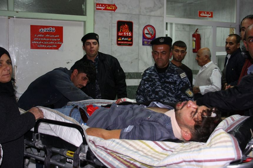 An earthquake victim is aided at Sulaimaniyah Hospital on Nov 12, 2017, in Sulaimaniyah, Iraq.