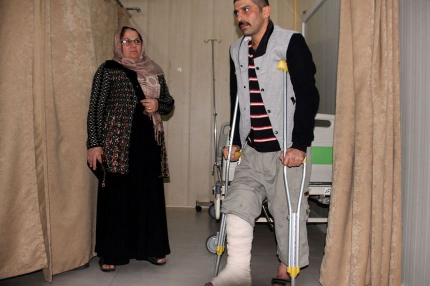 An earthquake victim is helped at Sulaimaniyah Hospital on Nov 12, 2017, in Sulaimaniyah, Iraq.