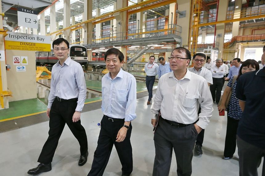 (From left) LTA chief executive Ngien Hoon Ping, Transport Minister Khaw Boon Wan and LTA deputy chief executive for infrastructure and development Chua Chong Kheng at  the Tuas West Depot on Nov 13, 2017.