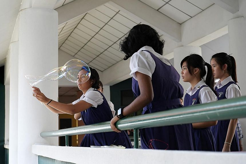 NJC students (from left) Liu Zimu, K. Mutthu Lakshmi, Megan Wee Rui En and Shi Lecheng collected data in an attempt to construct a relationship between the diameter of the base of a tree and its height. Such activities push students to go beyond the