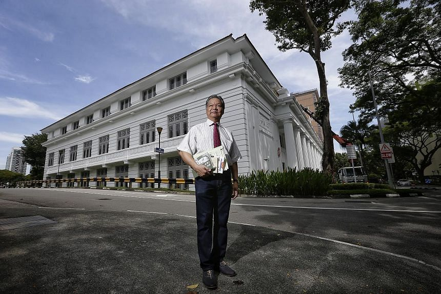 Researcher Lim Shaobin, who learnt through Japanese war documents that Singapore served as a base for the operation, seen here in front of the College of Medicine Building, which housed the Japanese research unit.