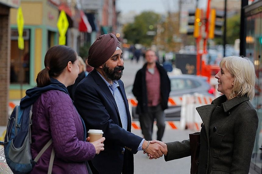Mr Ravi Bhalla greeting people in Hoboken, a city he has lived in for 17 years, last week. He has become one of only a few Sikhs to be elected mayor of an American city - and the first-ever for Hoboken, home to some 55,000 people in the state of New