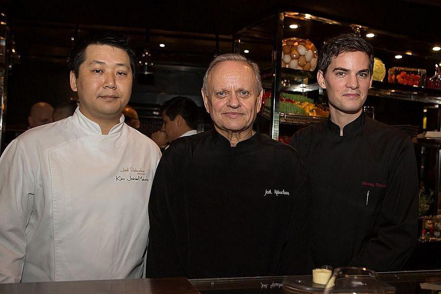 Celebrity chef Joel Robuchon (centre) with new chefs Kim Joinie-Maurin (far left) of Joel Robuchon Restaurant and Vianney Massot of L'Atelier de Joel Robuchon.