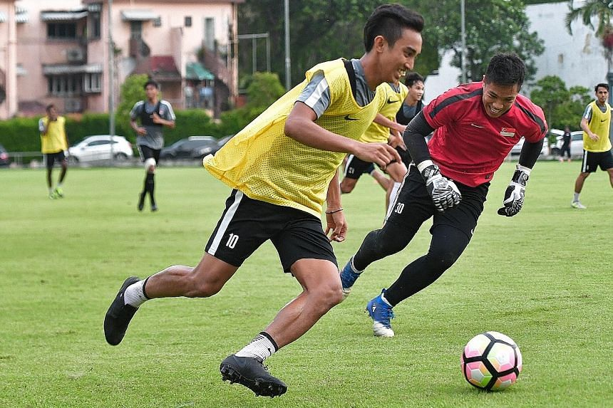 Faris Ramli (in yellow bib) enjoying national team training at the Geylang Field yesterday. The winger scored 11 goals for Home United in the S-League last season, but just once for the Lions this year.